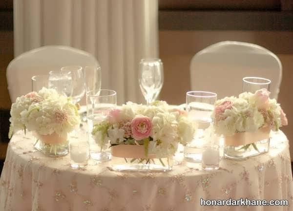 تزیین میز با شمع و گل طبیعی