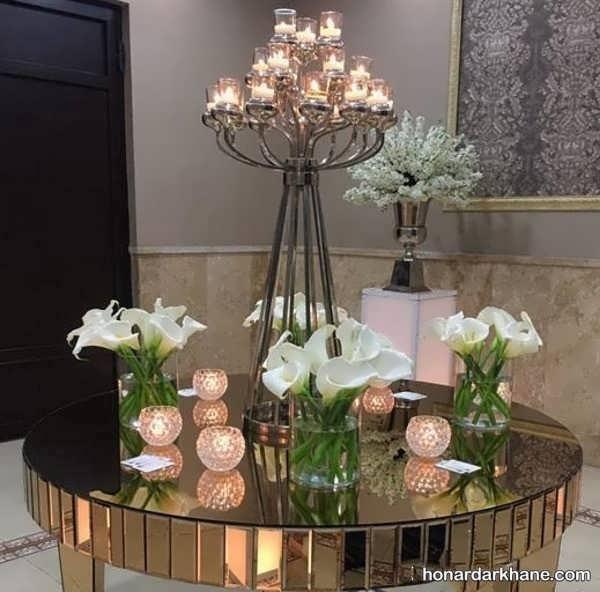 دیزاین میز با تزیین گل و شمع