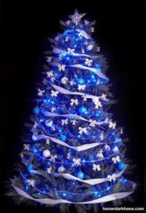 آراستن درخت کریسمس با تم برفی