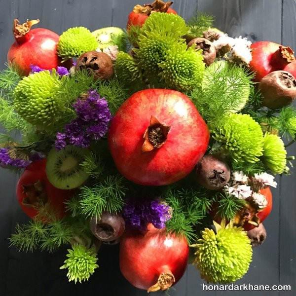 تزیین میوه  با گل طبیعی برای شب یلدا